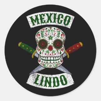 Adesivo Redondo México Lindo. Crânio mexicano com os punhais