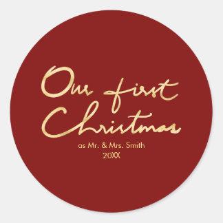 Adesivo Redondo Nosso primeiro Natal indicado por letras do Natal