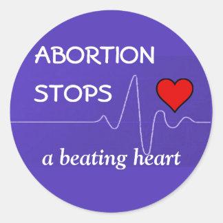 Adesivo Redondo O aborto para um coração batendo