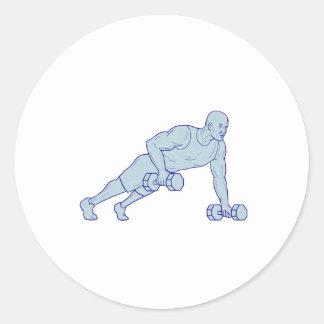 Adesivo Redondo O atleta da malhação levanta um desenho do