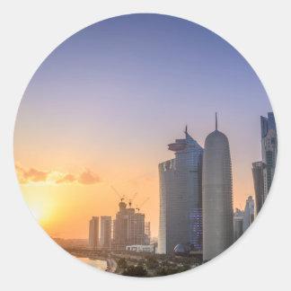 Adesivo Redondo Por do sol sobre a cidade de Doha, Qatar