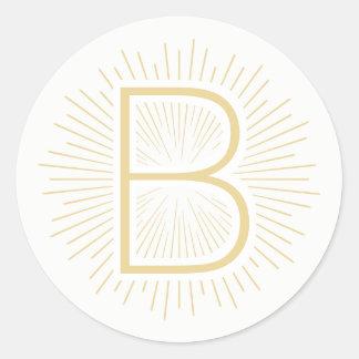 Adesivo Redondo Raios de brilho do ouro da letra do monograma do