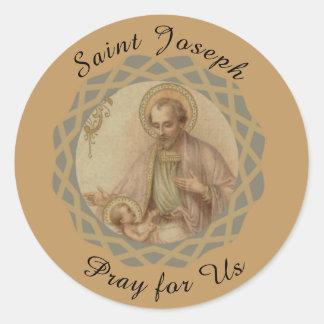 Adesivo Redondo St Joseph, bebê Jesus em um comedoiro