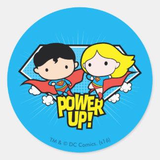 Adesivo Redondo Superman de Chibi & poder de Chibi Supergirl