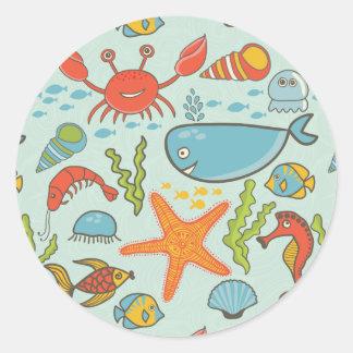 Adesivo Redondo Teste padrão marinho da criatura
