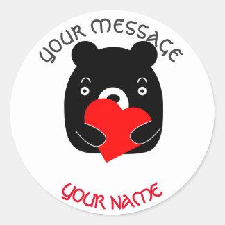 Adesivo Redondo Urso preto que guardara um coração