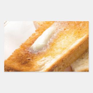 Adesivo Retangular Brinde quente com manteiga em um fim-acima branco