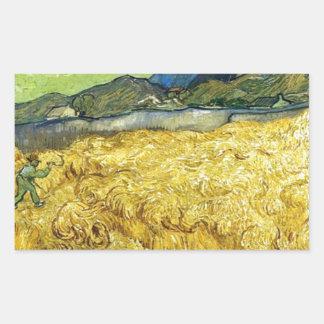 Adesivo Retangular Campos de trigo com a ceifeira no nascer do sol -