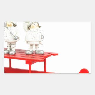 Adesivo Retangular Estatuetas do Natal das crianças no trenó vermelho
