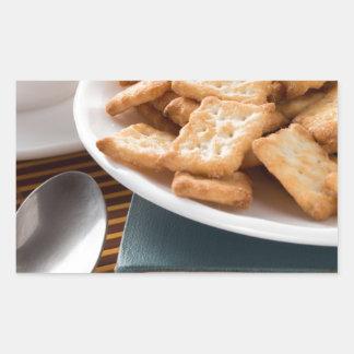 Adesivo Retangular Placa branca com os biscoitos no livro velho