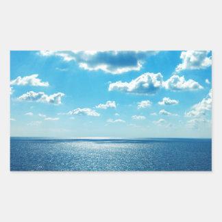 Adesivo Retangular Raios sobre o mar