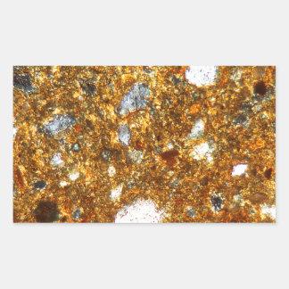 Adesivo Retangular Seção fina de um tijolo sob o microscópio