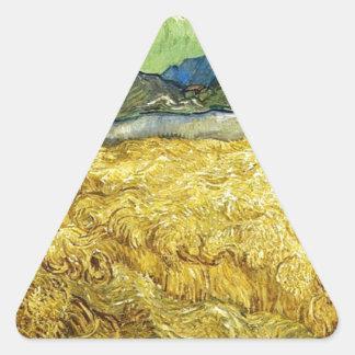 Adesivo Triangular Campos de trigo com a ceifeira no nascer do sol -