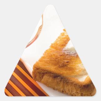 Adesivo Triangular Caneca de chá e de brinde quente com manteiga