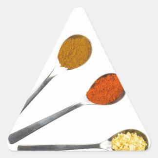 Adesivo Triangular Cinco especiarias de tempero em colheres do metal