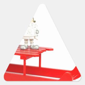 Adesivo Triangular Estatuetas do Natal das crianças no trenó vermelho