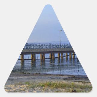 Adesivo Triangular Foto do cais no por do sol com âncora