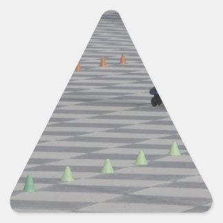 Adesivo Triangular Pés da cara em skates inline. Patinadores Inline