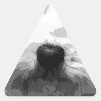 Adesivo Triangular Um maltês preto e branco