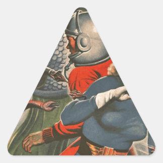 Adesivo Triangular Viajantes do espaço atacados pelo monstro do