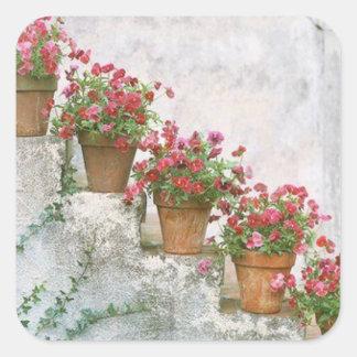 Adesivos flores na escada.