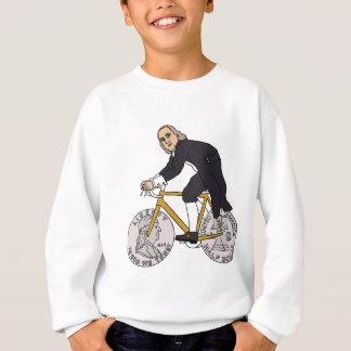 Agasalho Ben Franklin em uma bicicleta com as rodas do meio