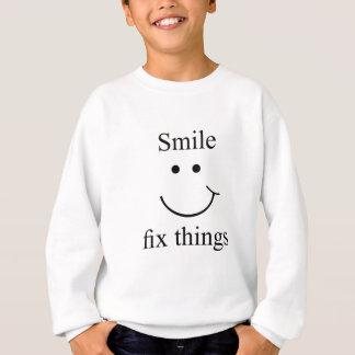 Agasalho Coisas do reparo do sorriso