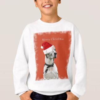 Agasalho Feliz Natal. Cão Dalmatian em um chapéu do papai