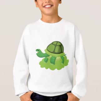 Agasalho tartaruga que anda na grama