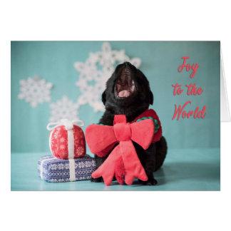 Alegria ao cartão do filhote de cachorro do Natal