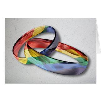 Alianças de casamento do arco-íris para a cartão