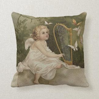 Almofada Anjo de sorriso pequeno com borboletas e harpa