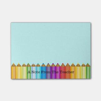 Almofada de nota do professor colorido dos lápis post-it notes