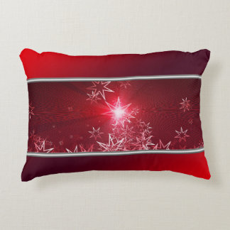 Almofada Decorativa Estrelas de prata em um fundo vermelho