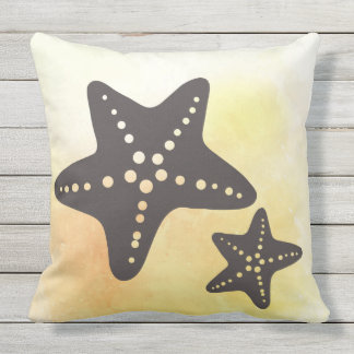 Almofada Silhueta dos peixes da estrela no amarelo