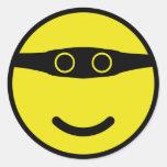 amarelo do smiley do sorriso do bandido adesivos em formato redondos