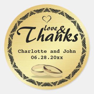 Amor e etiqueta do casamento do ouro dos obrigados