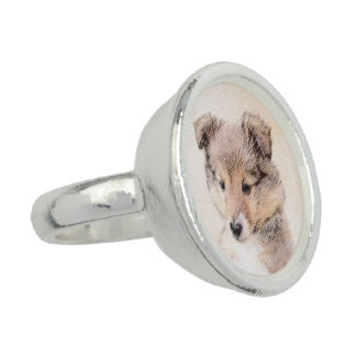 Anéis Com Fotos Filhote de cachorro do Sheepdog de Shetland que