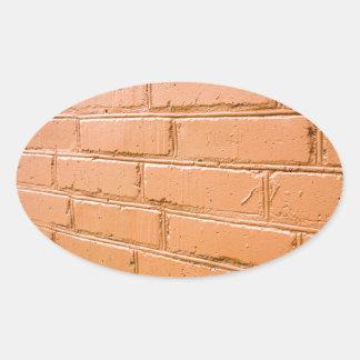 Ângulo de vista na parede de tijolo vermelho adesivo oval