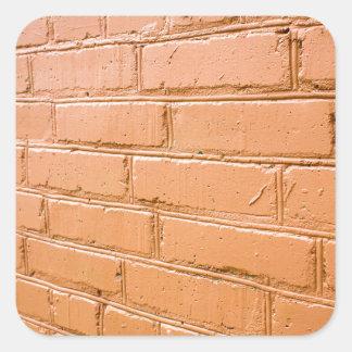 Ângulo de vista na parede de tijolo vermelho adesivo quadrado