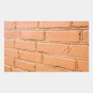 Ângulo de vista na parede de tijolo vermelho adesivo retangular