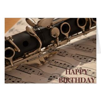 Aniversário do instrumento musical do clarinete cartão de nota