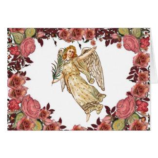 Anjo com coração cor-de-rosa dos rosas cartão comemorativo
