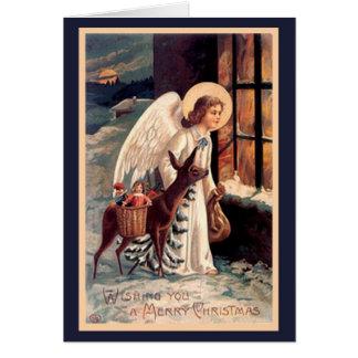 Anjo do Natal com cartão dos cervos