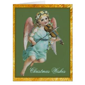 Anjo do Natal com o cartão grande do violino