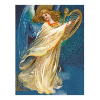 Anjo que joga a música em uma harpa cartões postais