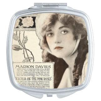 Anúncio do expositor do filme silencioso de Marion Espelhos Compactos