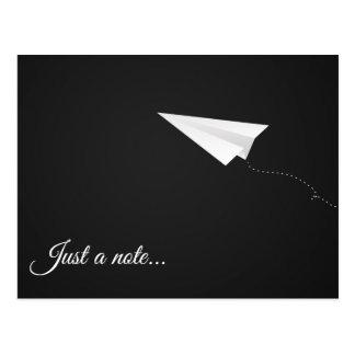Apenas um cartão do avião de papel de nota