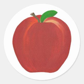 Apple vermelho maduro inteiro provem etiquetas da