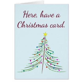 Aqui, tenha um cartão de Natal. Deixe-me agora